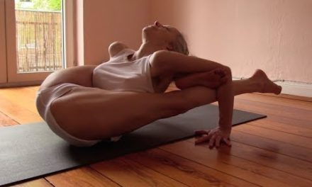Ashtanga Yoga – working the hip (leg behind the head)